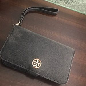Tory Burch wallet case that hold standard IPhone.